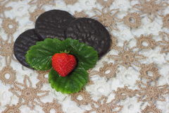 Strawberries with chocolate biscuits Stock Images