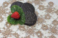 Strawberries with chocolate biscuits Royalty Free Stock Photos