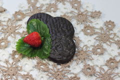 Strawberries with chocolate biscuits Stock Photo