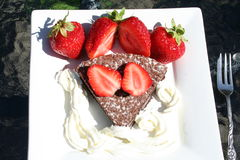 Strawberries and chocolate cake. Sweet Swedish strawberries with chocolate cake and cream is served to Midsummer in Sweden as dessert Stock Images