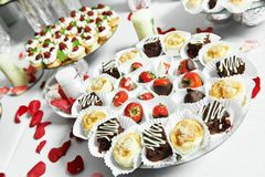 Strawberries with chocolate at catering party Stock Image