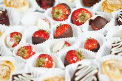 Strawberries with chocolate at catering party Royalty Free Stock Photo