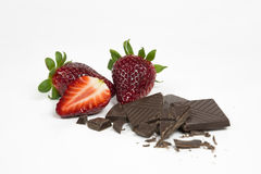Strawberries with chocolate. Juicy strawberries with pieces of a chocolate Royalty Free Stock Images