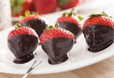 Strawberries in chocolate Stock Photos