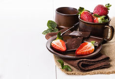 Strawberries and chocolate over white background Royalty Free Stock Photography