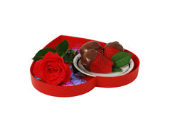 Strawberries in chocolate on red heart shaped tray Stock Photo