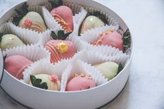 Gourmet chocolate covered strawberries in a round gift box royalty free stock photography