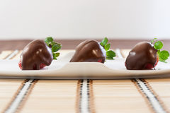 Strawberries with chocolate. On table mat for Valentine's day or other love related situation Royalty Free Stock Photography