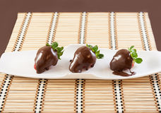 Strawberries with chocolate. On table mat for Valentine's day or other love related situation Stock Image