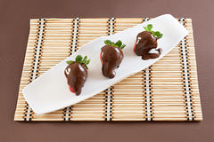 Strawberries with chocolate. On table mat for Valentine's day or other love related situation Royalty Free Stock Photo