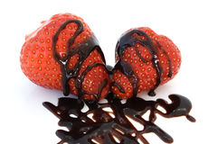 Strawberries with chocolate topping Stock Photos