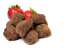 Strawberries and chocolate truffles Royalty Free Stock Image