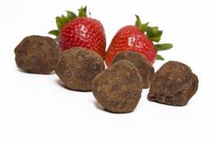 Strawberries and chocolate truffles Royalty Free Stock Photo