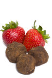 Strawberries and chocolate truffles Stock Image