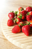 Strawberries on a chopping board Stock Photos