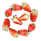 Strawberries in circle and sliced strawberry. Isolated on white Stock Images