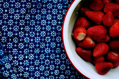 Strawberries. Classic strawberries in tin bowl on decorative tablecloth royalty free stock photography