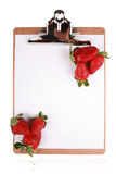 Strawberries on clipboard Royalty Free Stock Photos