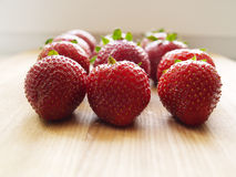 Strawberries. Close up a strawberry matrix on wooden background Royalty Free Stock Images