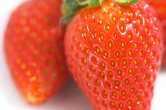 Strawberries Closeup. On White, shallow depth of field stock photography