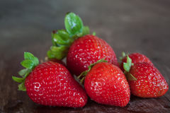 Strawberries closeup on wood Royalty Free Stock Photo