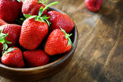 Strawberries closeup in wooden bowl Stock Photography