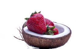 Strawberries in a coconat bowl. Healthy concept. Strawberries in a coconat bowl. Beautiful juicy and bright strawberryes in a bowl of half coconut on white stock images