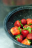Strawberries in a colander. Fresh strawberries in a black colander Royalty Free Stock Image
