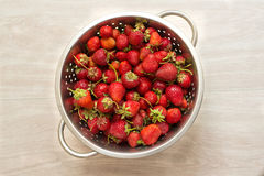Strawberries in a colander Royalty Free Stock Photos