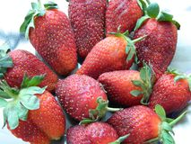 strawberries collected for the girlfriend stock images