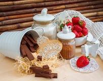 Strawberries, cookies, chocolates candies Stock Photo