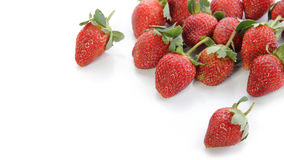 Strawberries with copyspace. Some natural strawberries in diagonal tilt shot, isolated over white background for copy space royalty free stock photos