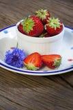 Strawberries and cornflowers Stock Photos