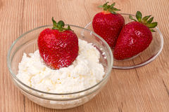Strawberries and cottage cheese Royalty Free Stock Images