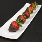 Strawberries covered with chocolate Royalty Free Stock Images