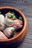 Strawberries covered with chocolate in the wooden bowl. Selective focus. Shallow depth of field royalty free stock photo