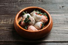 Strawberries covered with chocolate in the wooden bowl. Selective focus. Shallow depth of field stock photo