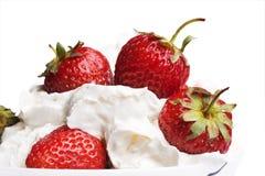 Strawberries in cream Stock Photography