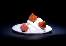 Strawberries with cream. On a white saucer Stock Photography