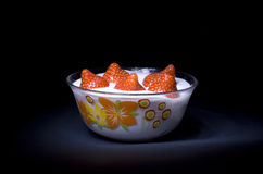 Strawberries with cream. In a transparent plate Royalty Free Stock Image