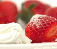 Strawberries and Cream. Sliced strawberry with sugar and cream Stock Photos