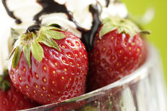 Strawberries and cream. Strawberries with cream and chocolate sauce royalty free stock images