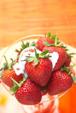 Strawberries and cream Stock Images