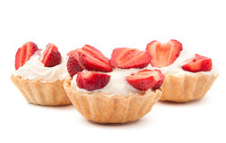 Strawberries and cream in a basket Stock Images