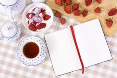 Strawberries cream bowl, recipe book, copy space Stock Photography