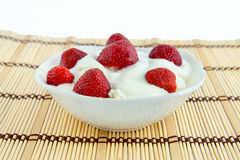 Strawberries with cream cheese and sour cream. Royalty Free Stock Photos