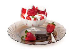 Strawberries with cream and chocolate Stock Photos