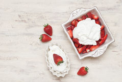 Strawberries with cream. Dish of strawberries and cream Stock Photos