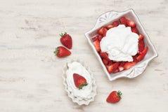 Strawberries with cream Stock Photos