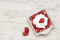 Strawberries and cream. Dish of strawberries and cream Royalty Free Stock Images